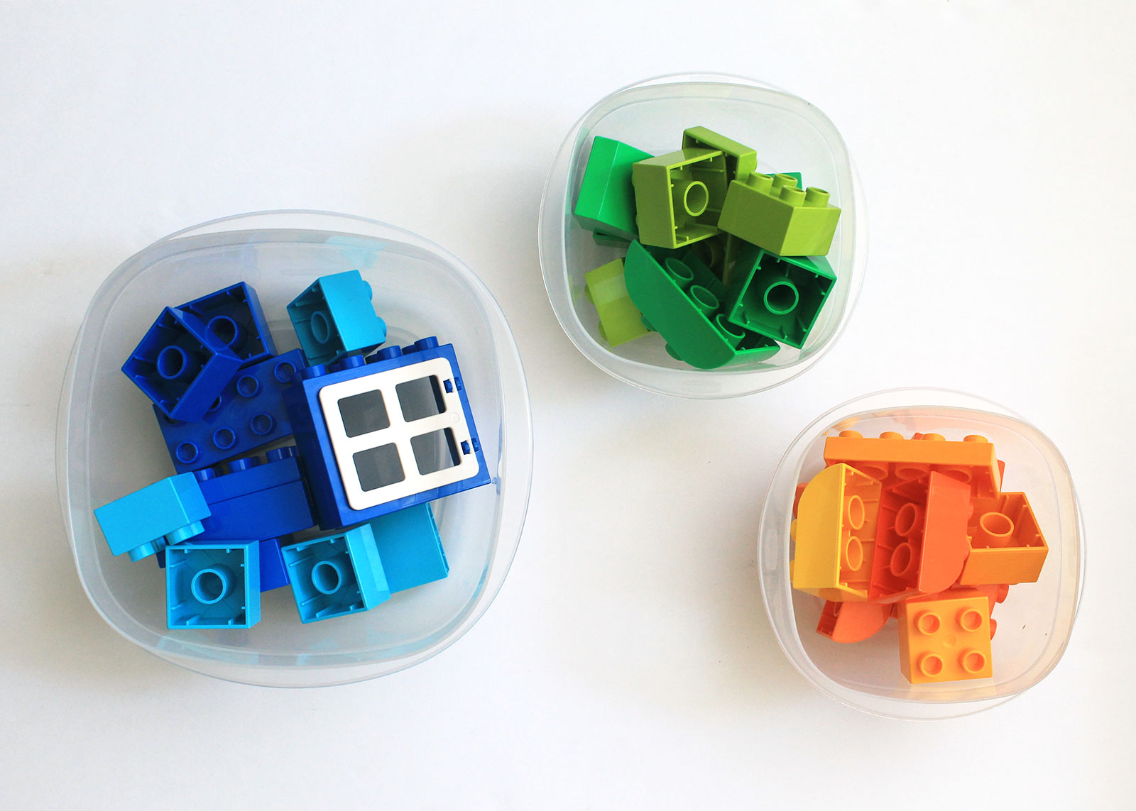 Repurpose plastic containers to store small toys