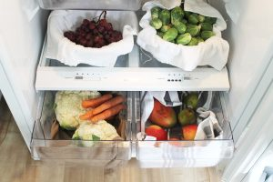 Make food last with eco friendly, reusable refrigerator shelf liners that you likely already have in your home.